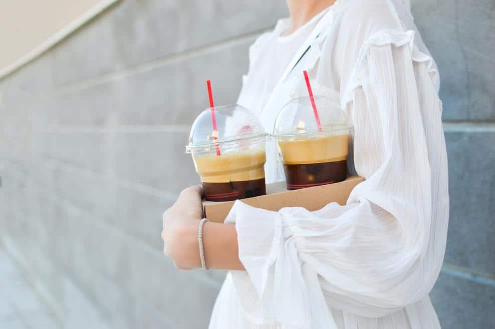Woman holding iced coffee
