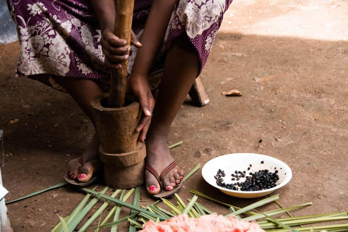 Grinding coffee beans during a traditional Ethiopian coffee ceremony.
