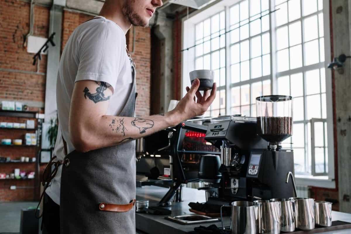 Coffee barista working in a coffee shop.