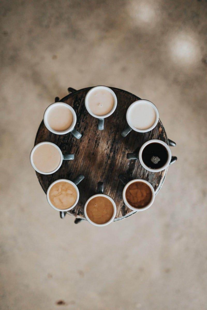cups of coffee arranged on a circular platform