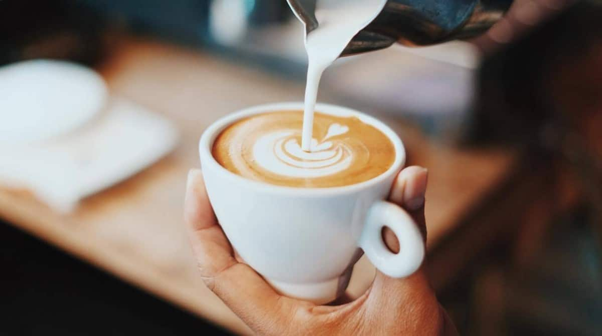 Milk is a good source of calcium and adding it to coffee offsets the net calcium change.