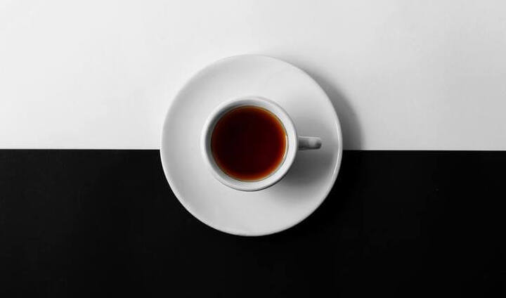 coffee on a black and white platform