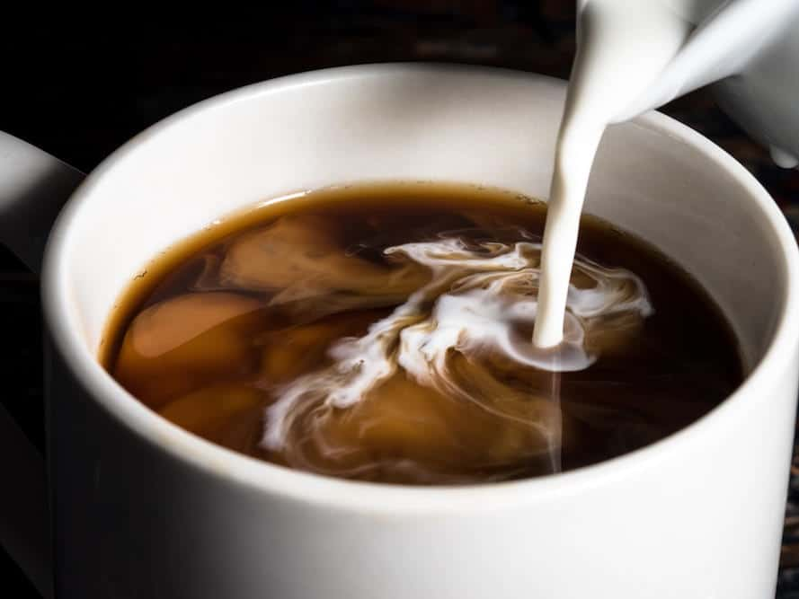 Milk swirling smoothly in a cup of espresso.