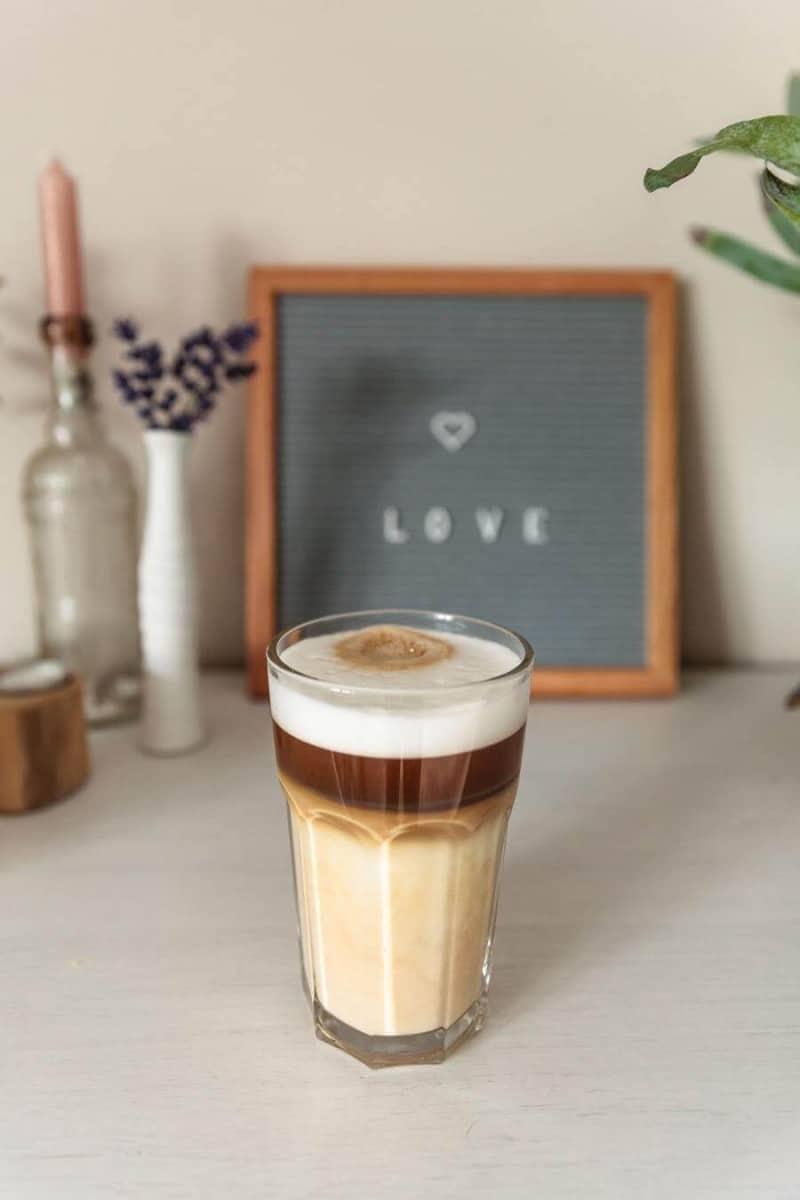 Café latte in clear glass.