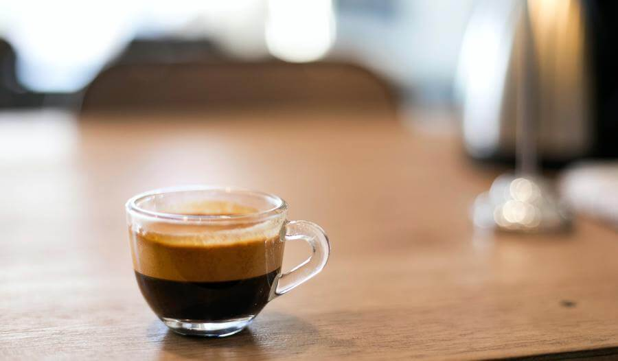 a tiny cup of ristretto on a wooden table