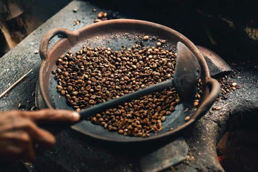 A person roasting their own coffee beans