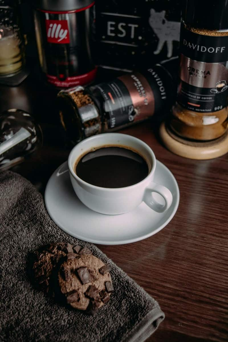 coffee surrounded by jars of instant coffee