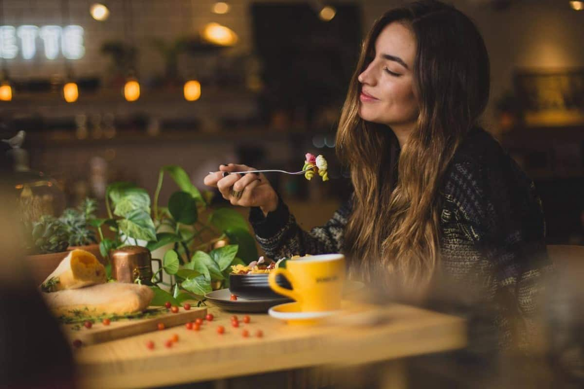 person having coffee while eating.