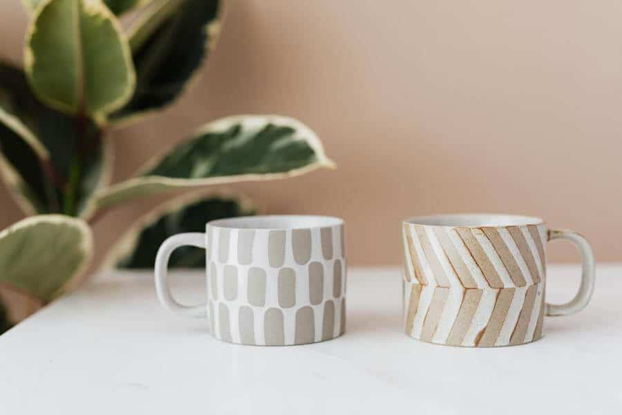 two differently patterned mugs on a white table