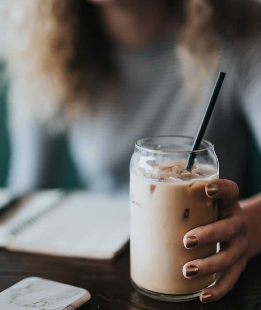 vanilla iced coffee in a woman's hands