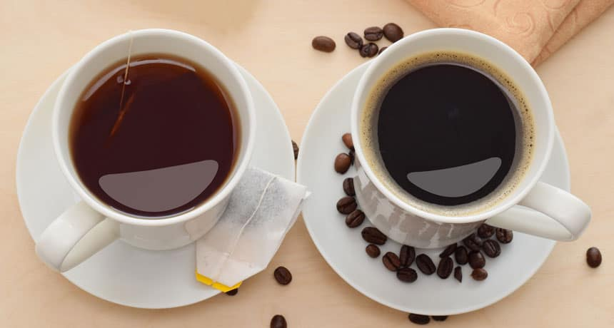 a cup of coffee next to a cup of tea