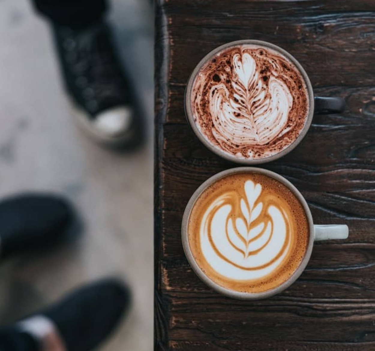 two cups of coffees with latte art