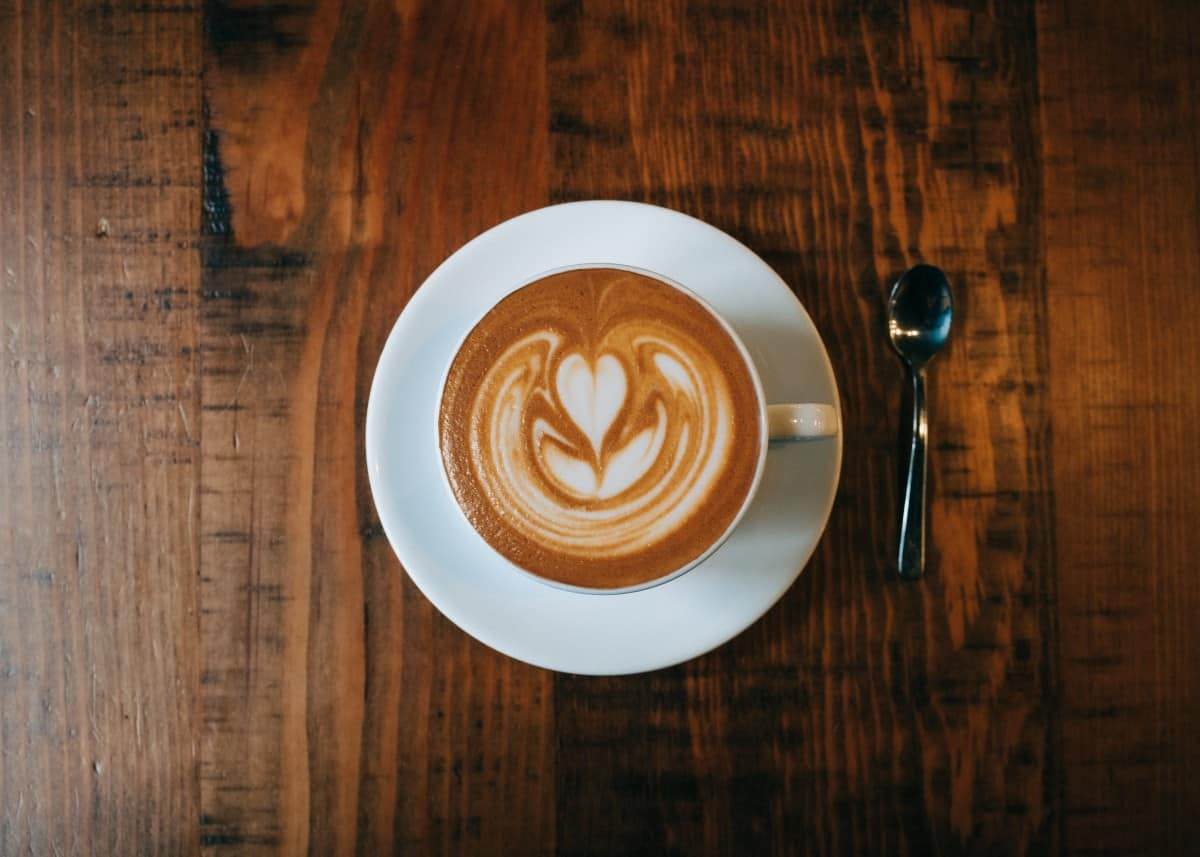a delicious cup of flat white on wooden table