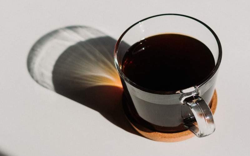 black coffee in a clear glass cup