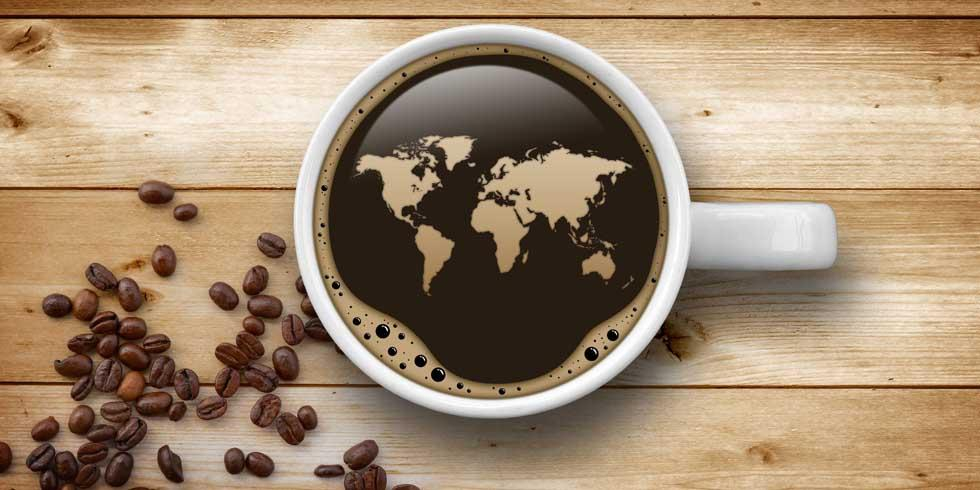 a cup of coffee with shapes of countries on it