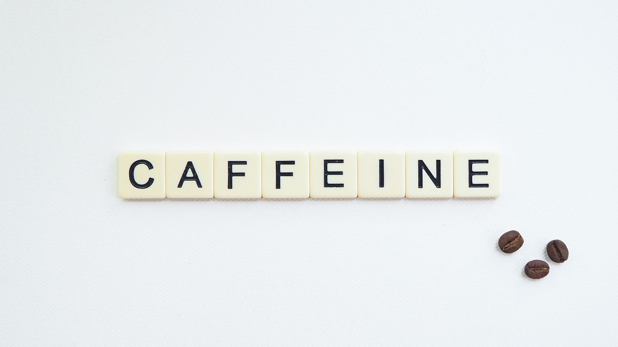 scrabble blocks spelling out the word 'caffeine'