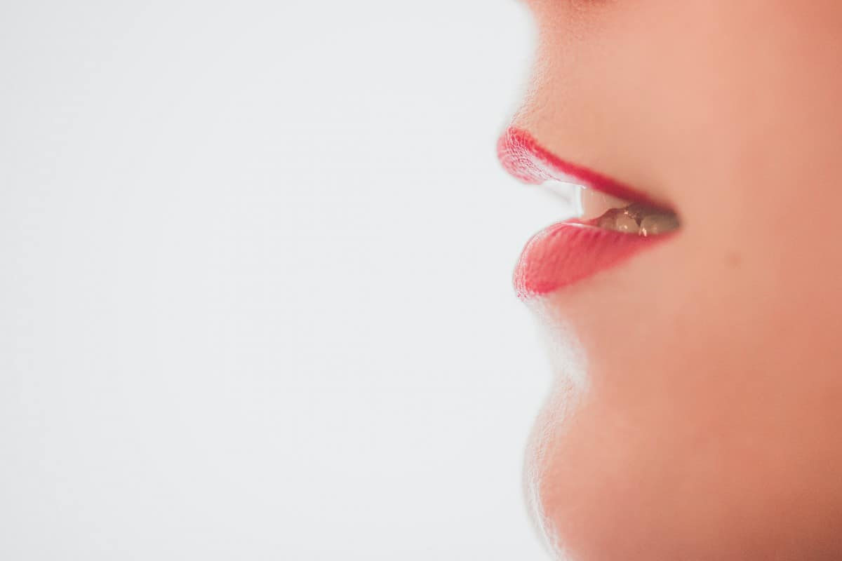 A close up of person's mouth